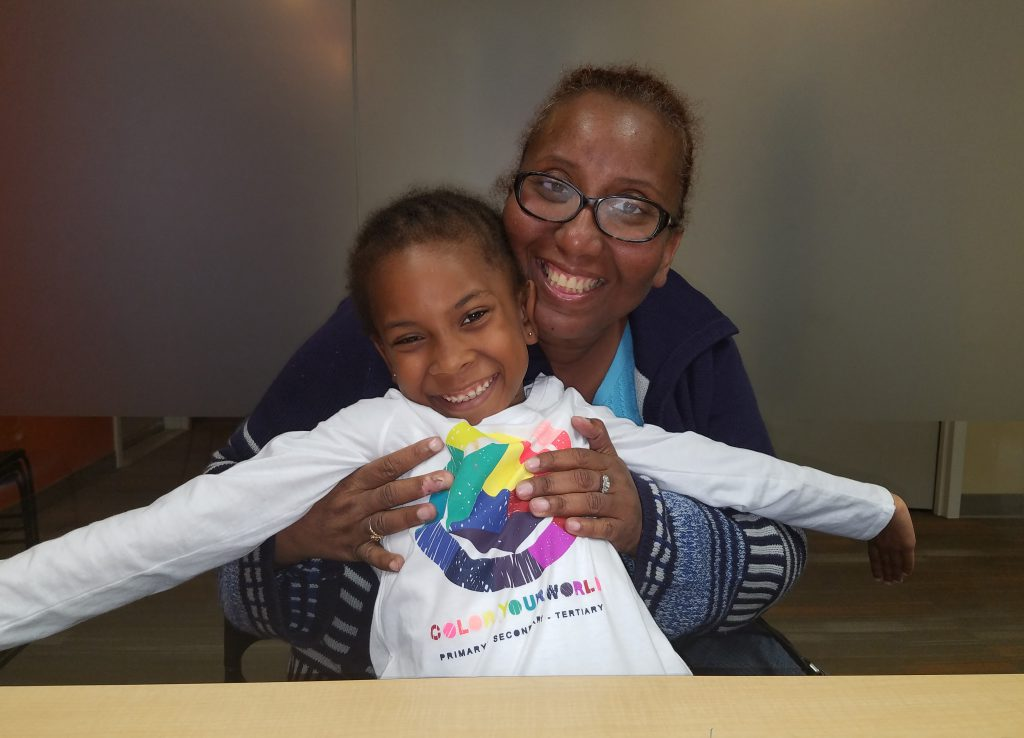 Consumer Advisory Committee member and longtime client, Carolynne, with her daughter